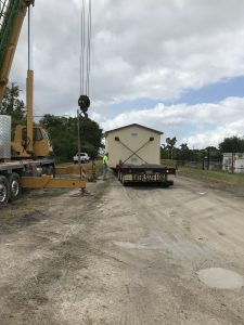 Delivery of prefabricated utility building